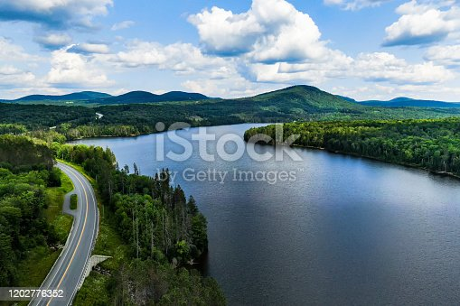 Aerial photography of Vermont`s landscape. Winding roads, embraced by green and pure nature, lakes and mountains.