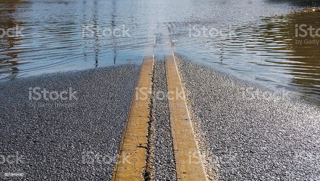 Road Leading into Flooded Street stock photo