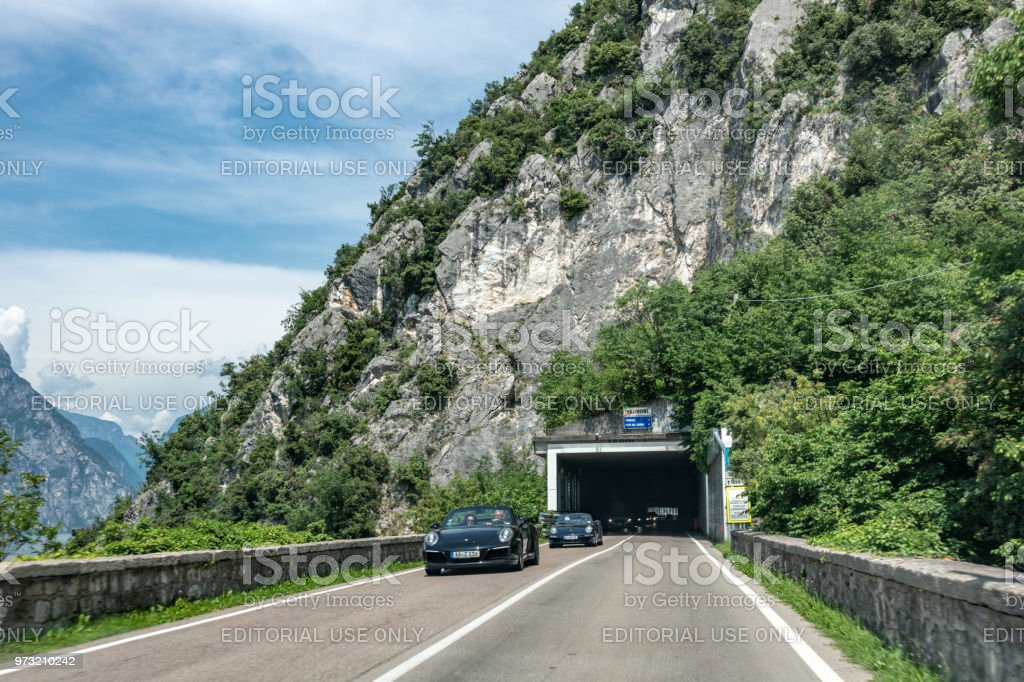 Road leading to a tunnel on Lake Garda, Italy stock photo
