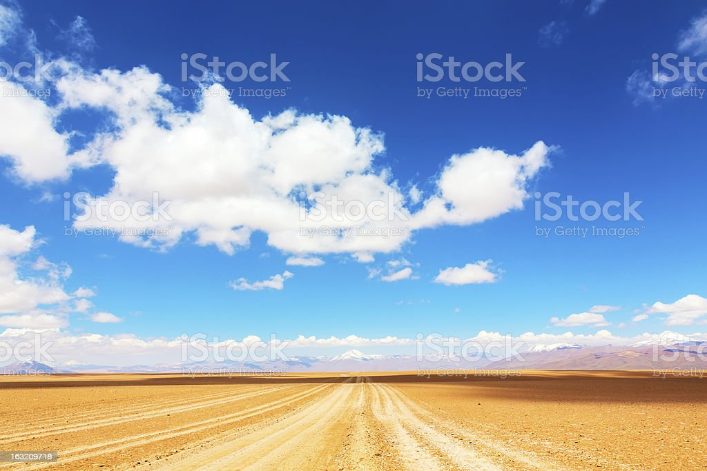 Road leading to mountains royalty-free stock photo