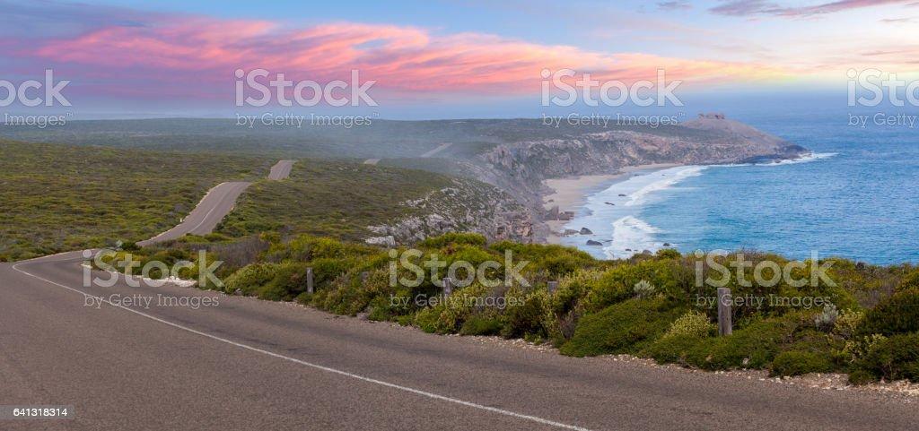 Road leading to Remarkable Rocks among native coastal vegetation at sunset. Flinders Chase National Park, South Australia stock photo