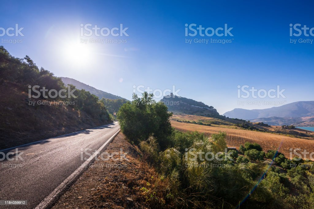 Road leading uphill to the town of Zahara de la Sierra in Spain - Royalty-free Andalucian Sierra Nevada Stock Photo
