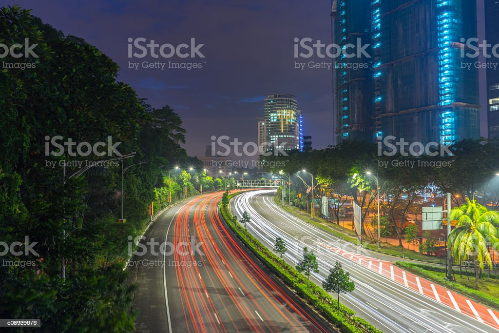 Road leads to a building and sunrise stock photo