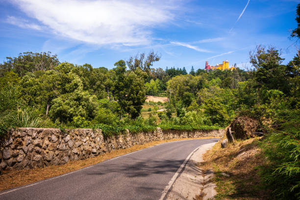 Road leads to Pena Palace atop the hills of Sintra, Portugal stock photo