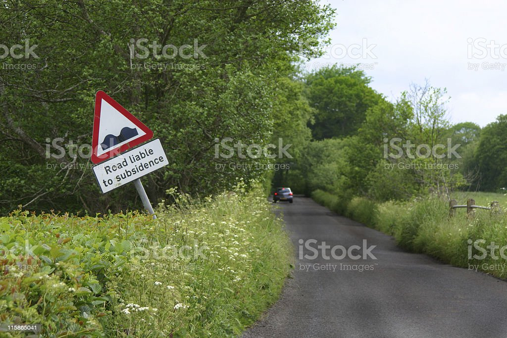 Road liable to subsidance stock photo