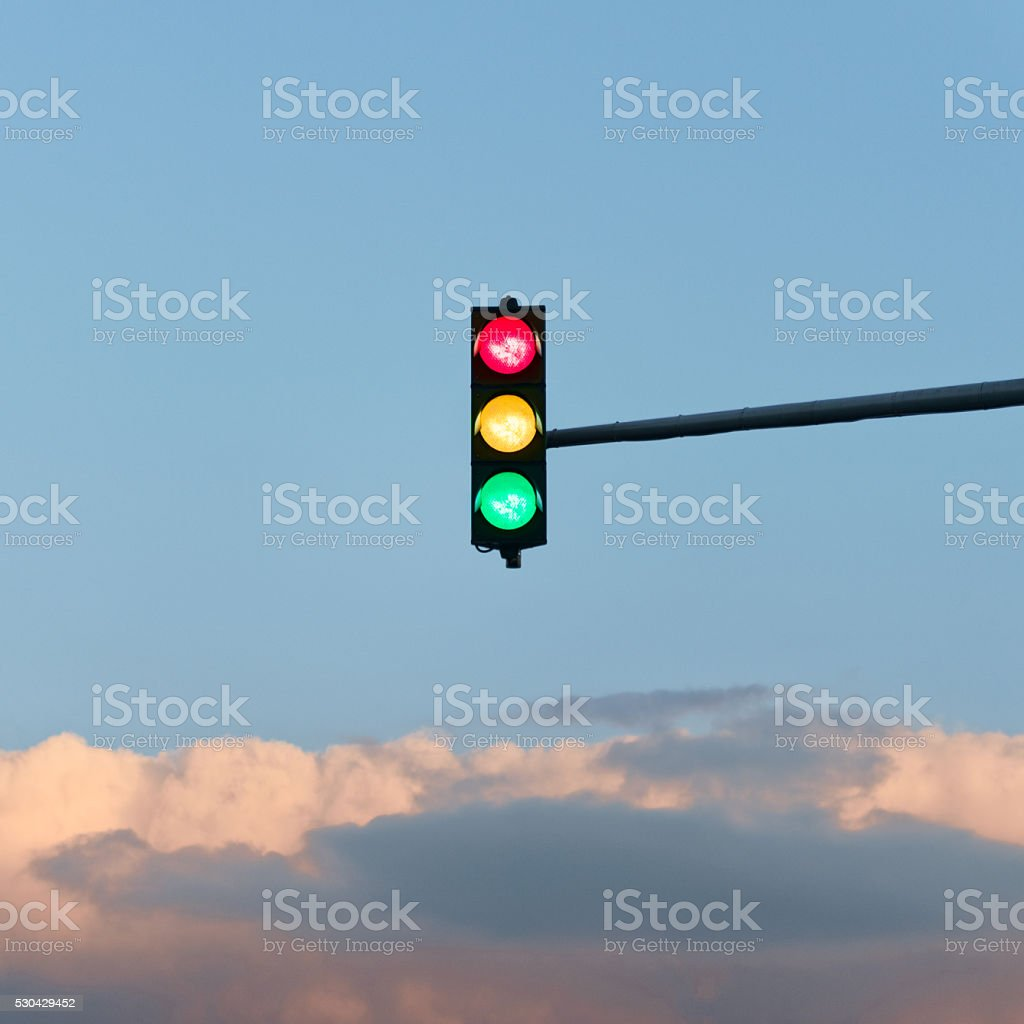 Road lights in red, yellow and green stock photo