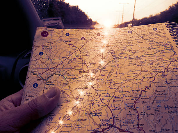 road map with illuminated trail of lights - road map stock photos and pictures