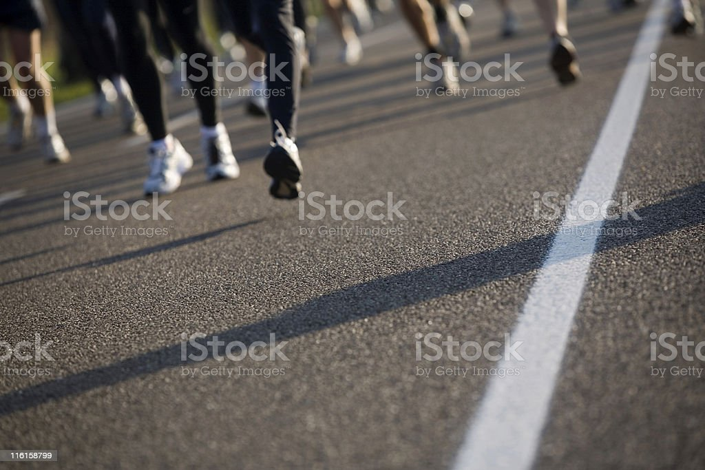 road marking with running athletes out of focus royalty-free stock photo