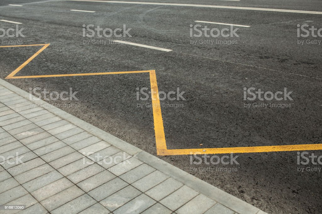 Road markings indicating no stopping or parking stock photo