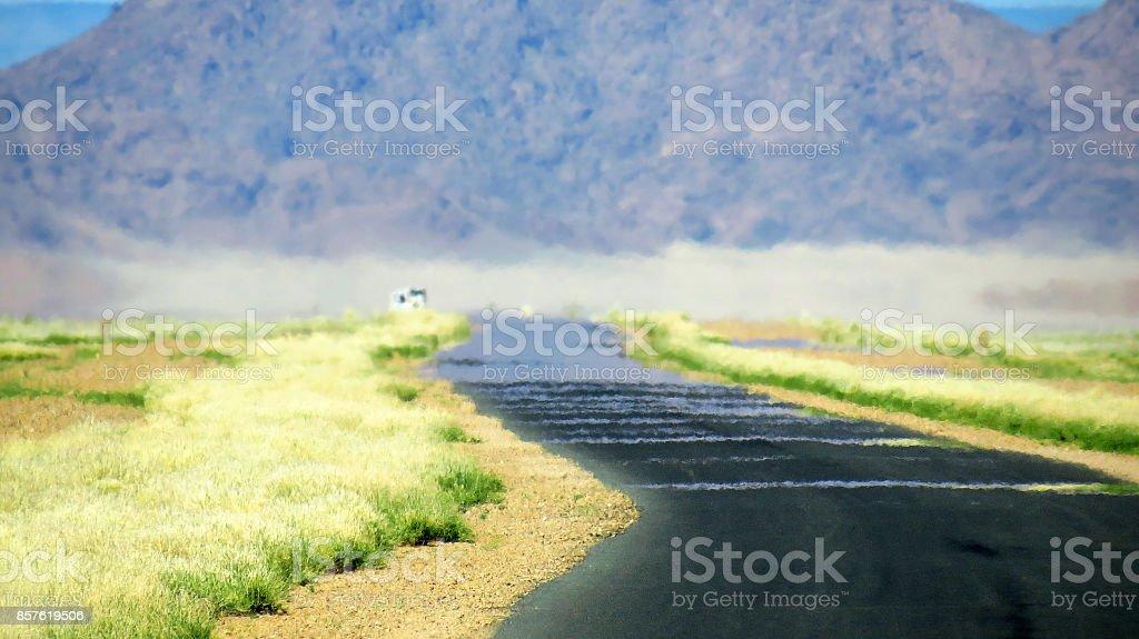 Road mirage hot reflection desert travel journey destination dry Africa stock photo