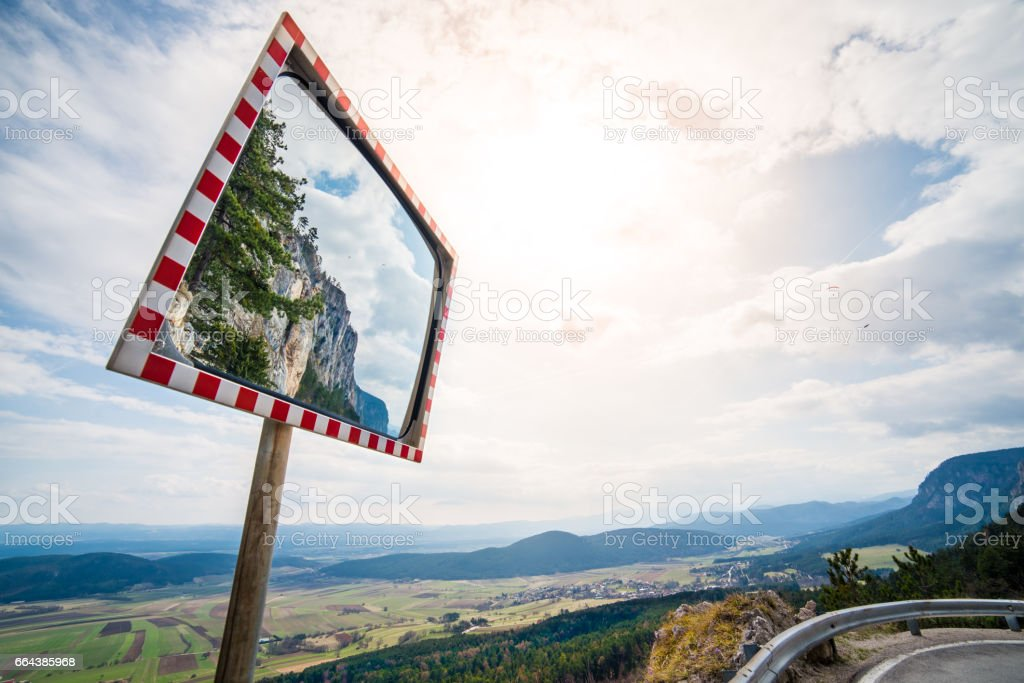 road mirror on a road to a mountain - Hohe Wand  - copy space stock photo