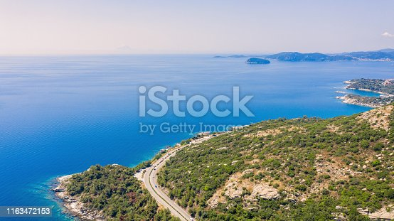 811600544 istock photo Road near the sea. 1163472153