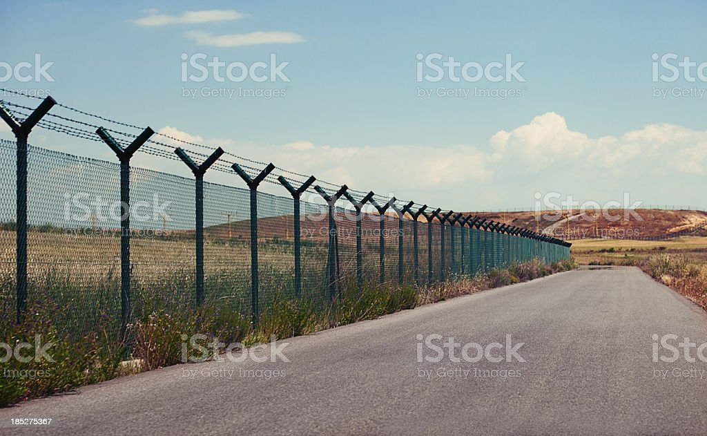 Road next to a fence stock photo