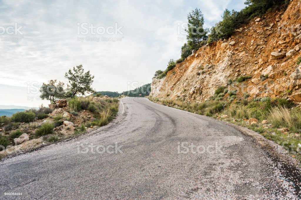 A road next to a sloping slope stock photo