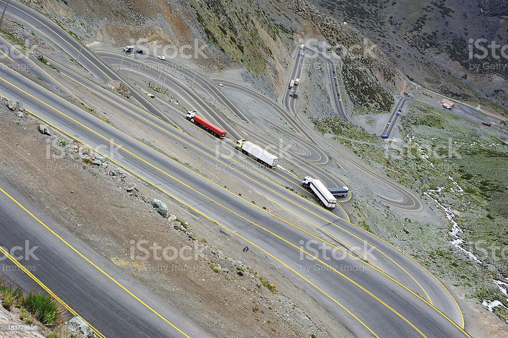 Road of 29 curves from above, trucks up and downhill royalty-free stock photo