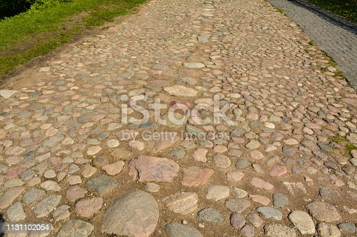 Pavement of flat stones near the fortress of Izborsk, Russia
