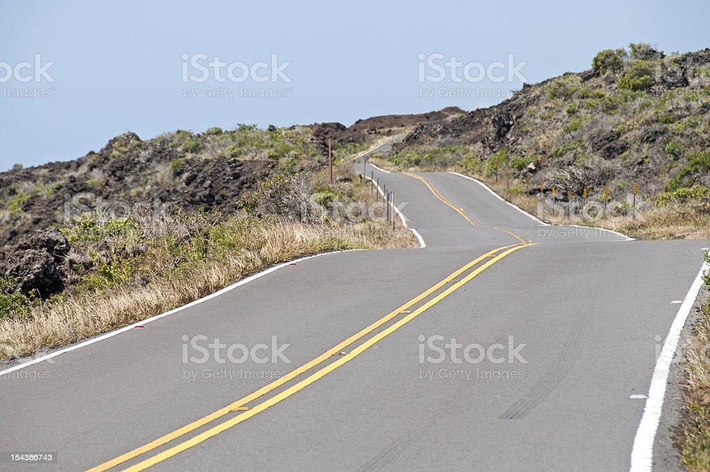 Road on side of Haleakala volcano in Maui stock photo