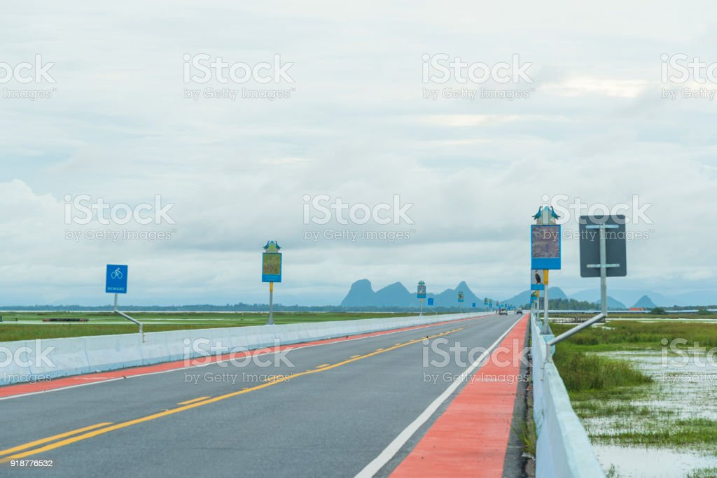 road on the lake view, Thailand stock photo
