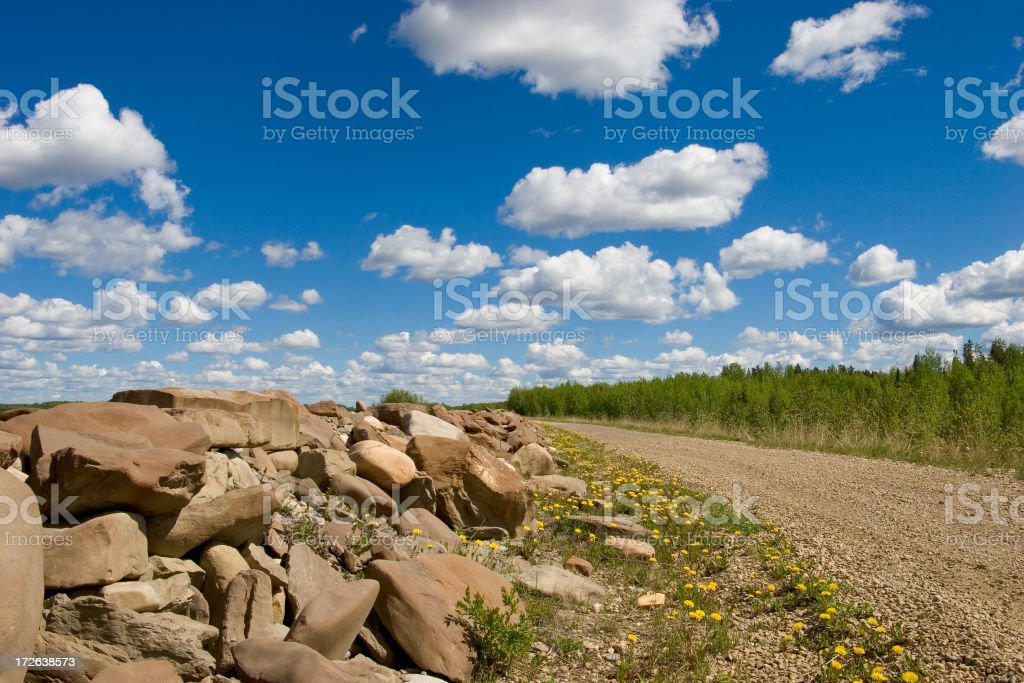 road on the top of a dike at a hydro dam royalty-free stock photo