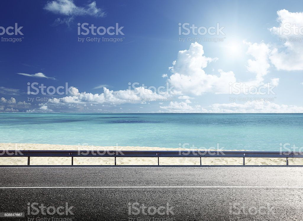 road on tropical beach stock photo