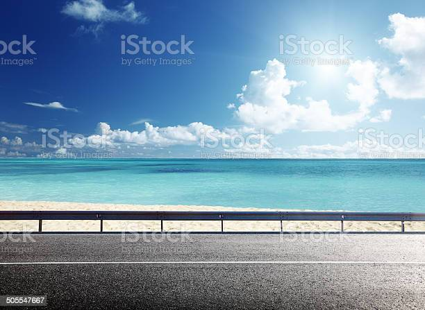 Photo of road on tropical beach