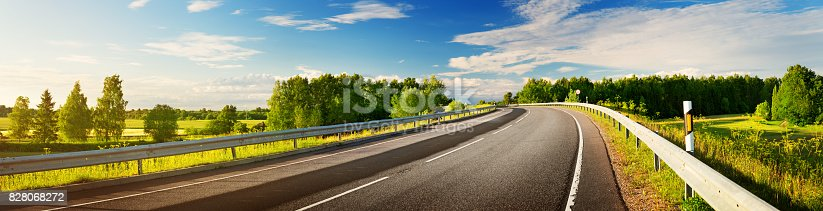 istock Road panorama on sunny spring evening 828068272