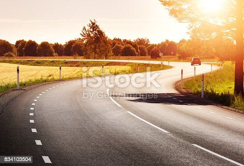 istock Road panorama on sunny spring evening 834103504