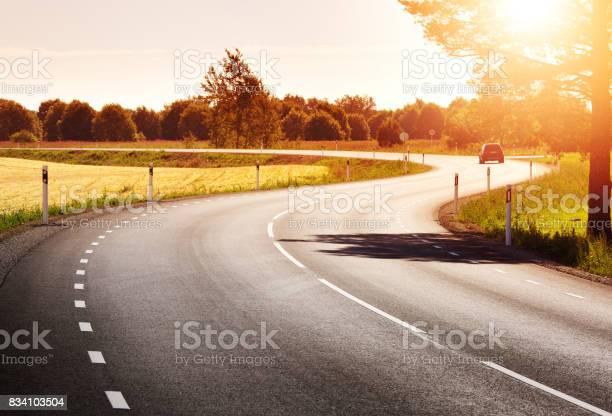 Photo of Road panorama on sunny spring evening