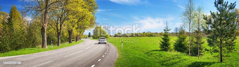 istock Road panorama on sunny summer day 1040539160