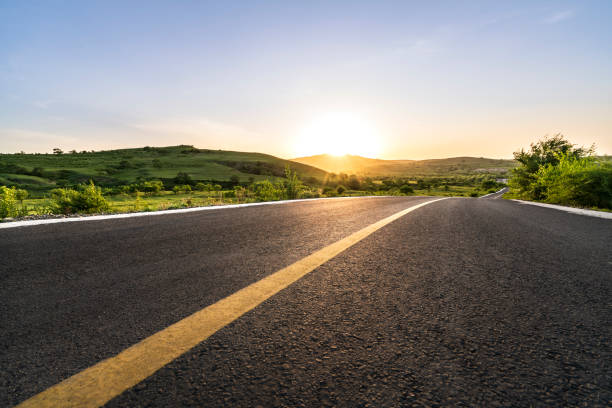 Road Curved mountain road, road trip stock pictures, royalty-free photos & images