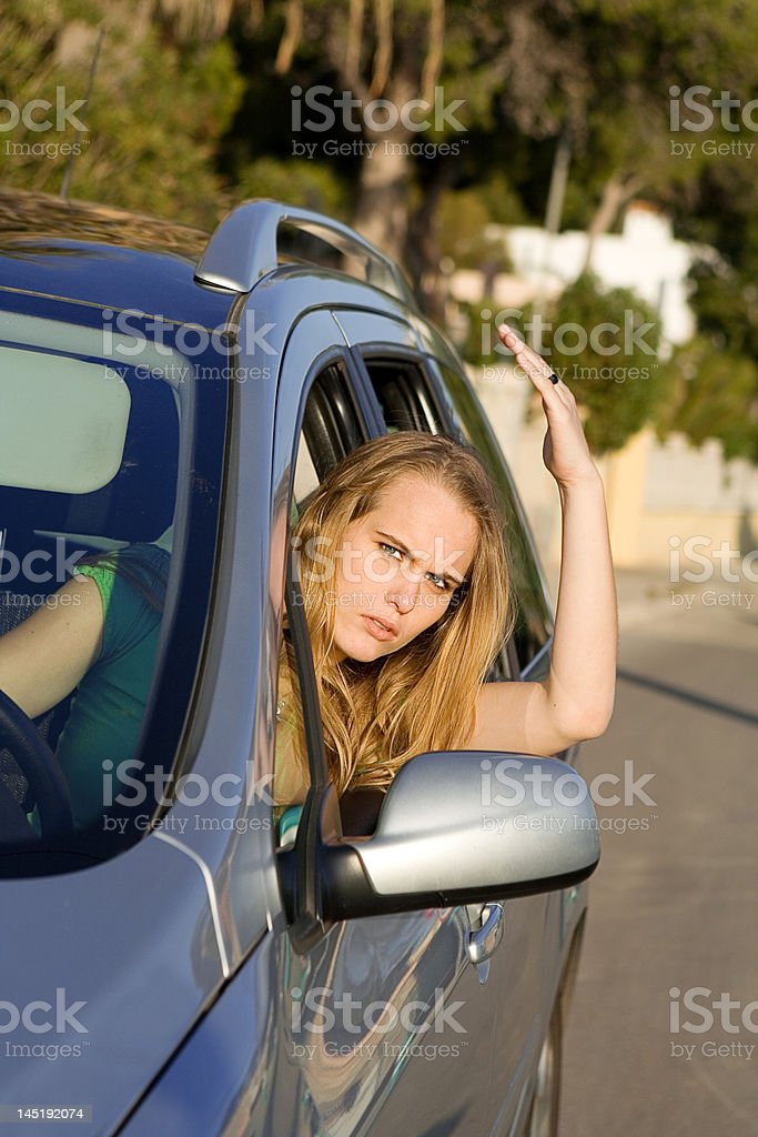 road rage, angry young woman in car royalty-free stock photo