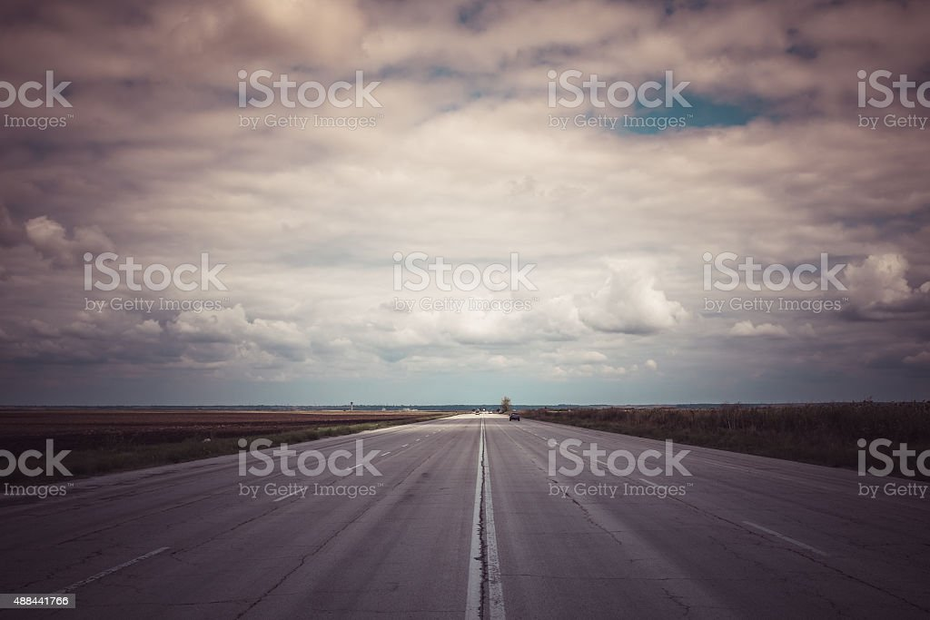Road reaching the horizon, freedom concept stock photo