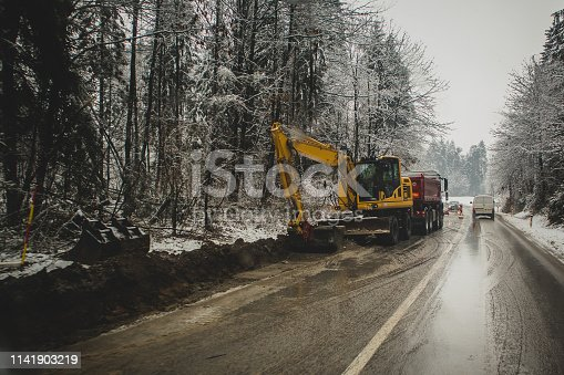istock road repair in winter 1141903219