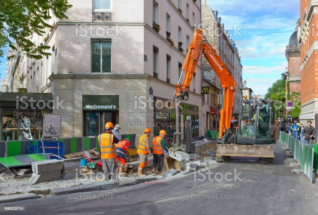 Road repair site on street Rue Buffon in Paris, France stock photo