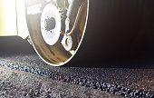 istock Road repair, thin layer of new asphalt close-up and road roller 1241641292