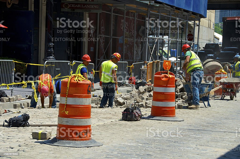 Road repair workers in Lower Manhattan, New York City royalty-free stock photo