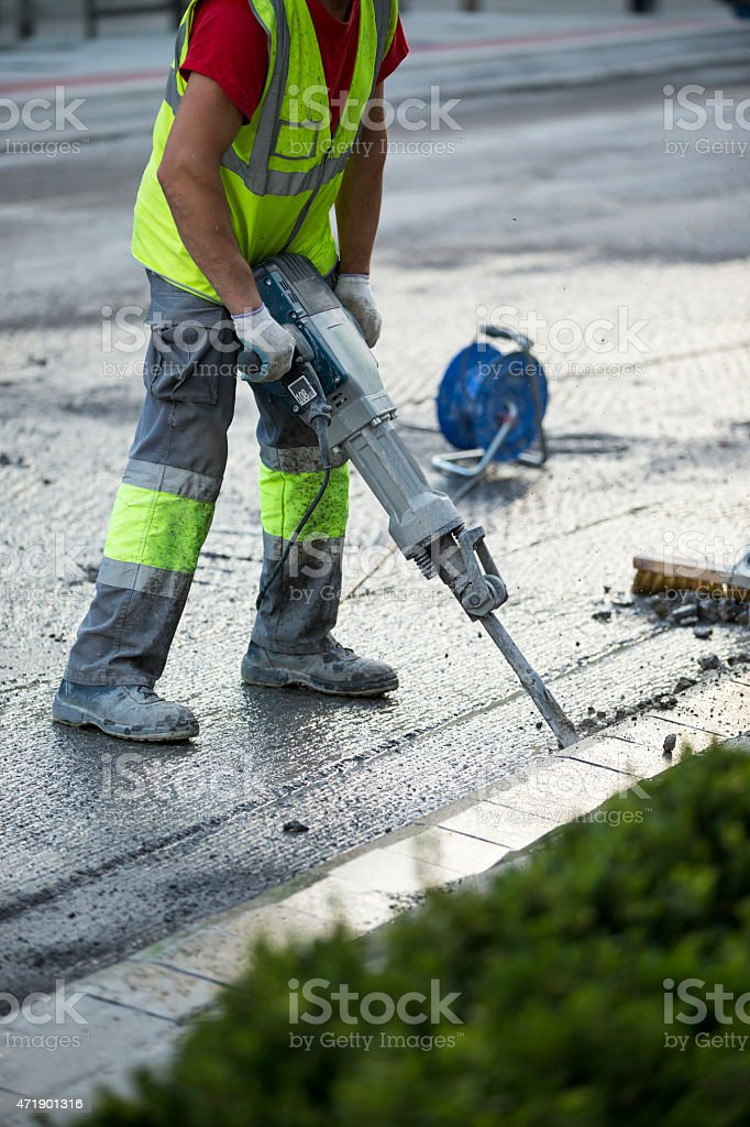 Road repairing works with jackhammer stock photo