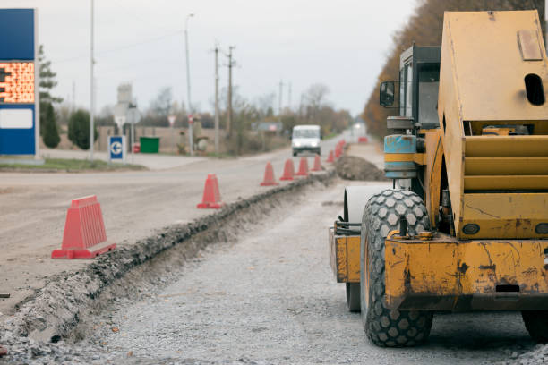 Road repairs, warning signs. Track laying concept stock photo