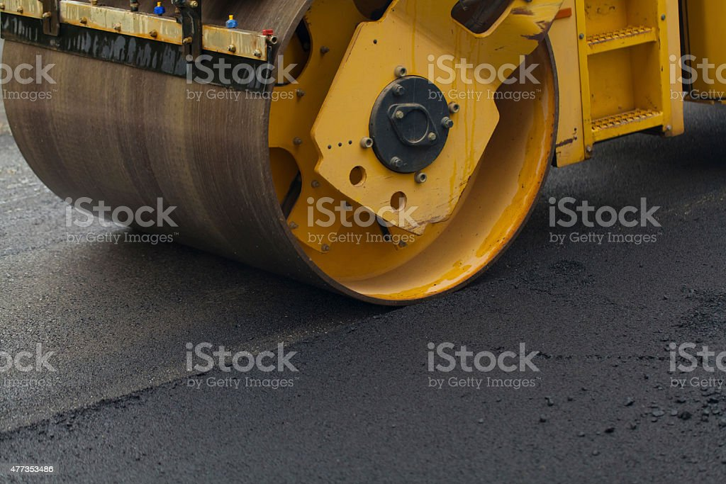 road roller flattening new asphalt stock photo