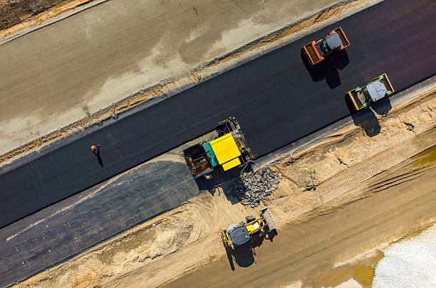Road rollers working on the construction site aerial view stock photo