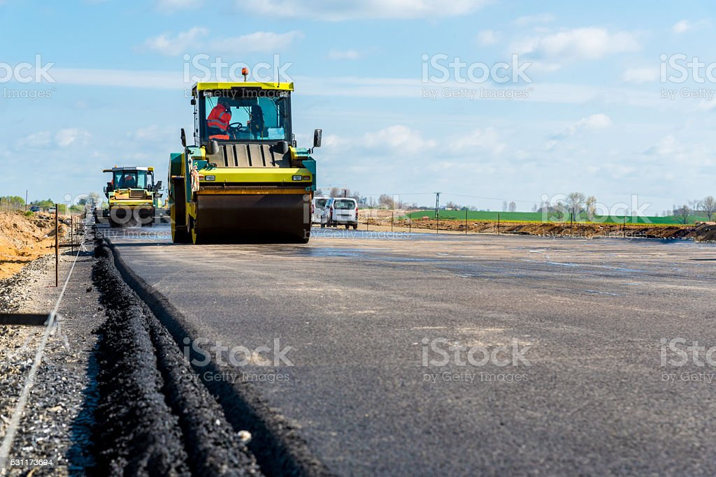 Road rollers working on the construction site stock photo