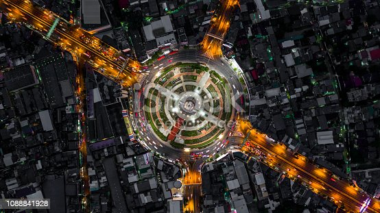 istock Road roundabout with car lots, road traffic in Bangkok city at night, Aerial top view, Wongwainyai, Bangkok, Thailand. 1088841928