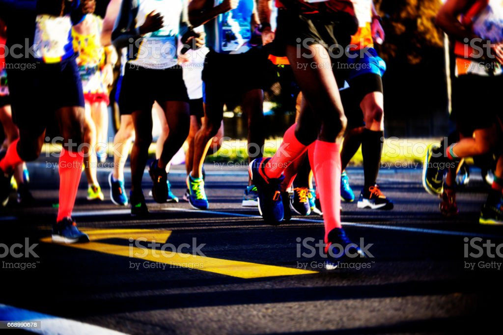 Road runners legs stock photo