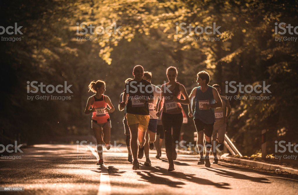 Road running race at sunset! stock photo