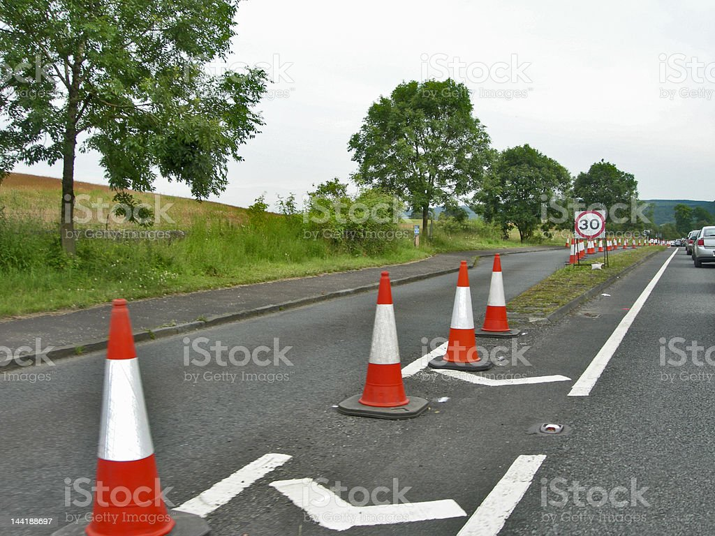 Road safety cones and sign royalty-free stock photo