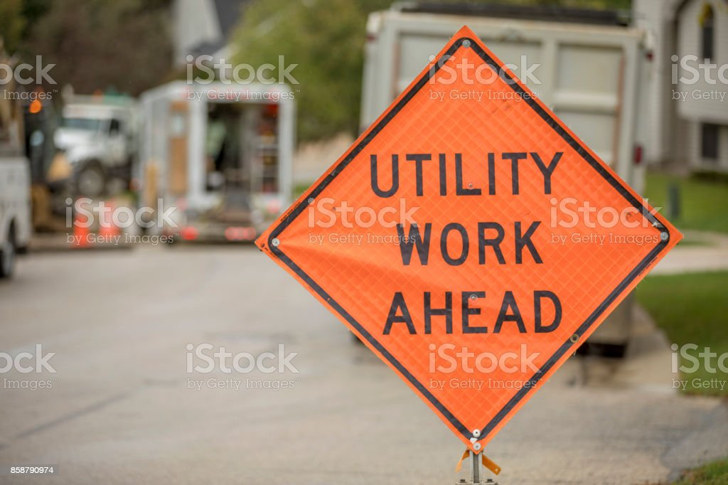 Road construction safety sign, Utility Work Ahead, while repairing a...