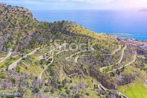 1042711480 istock photo Road serpentine uphill on the coast of Sicily Italy Palermo. 1153447577