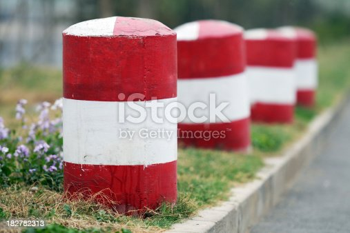 Red stone pillar at road side