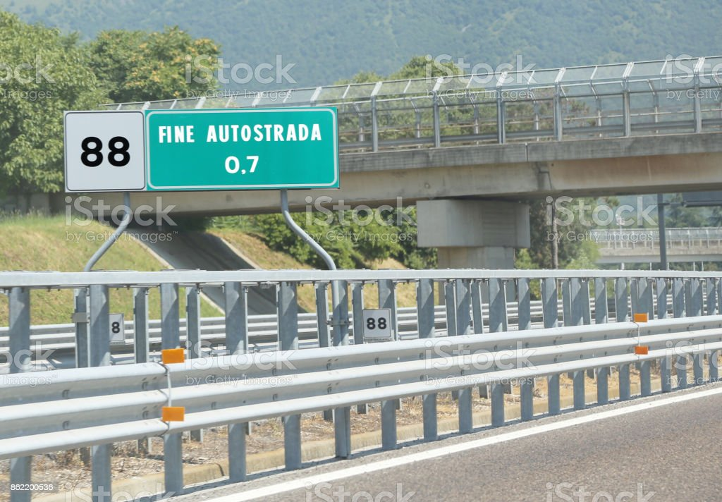 road sign at end of motorway  and the text Fine Autostrada that stock photo