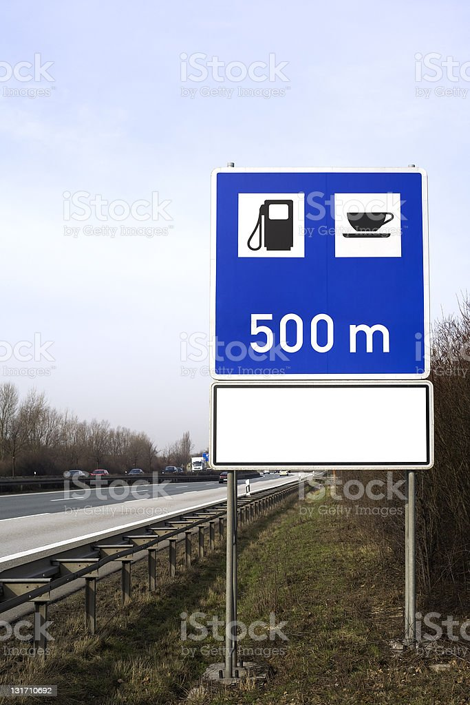 Road sign at the highway - next petrol station 500m royalty-free stock photo